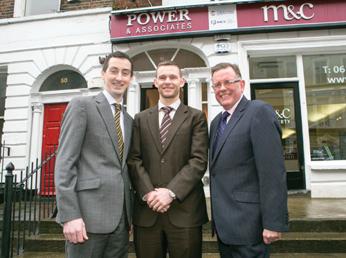 Andrew Carberry (centre) is welcomed to Power & Associates by PJ Power, managing director (right) and Patrick Seymour, director (left). Photo: Brian Gavin