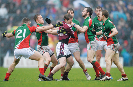 Gavin Hoey, Westmeath, is surrounded by Mayo players in last Sunday's game.