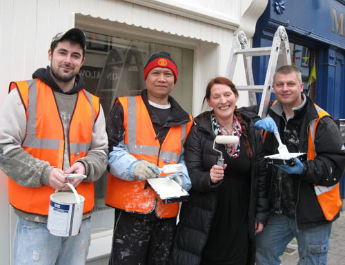 The Facelift Project team get busy on Main Street, Castlebar. Photographed from left: John Kinsella, Po Kweh, Helen O'Hara, and Robert Swierkowski.
