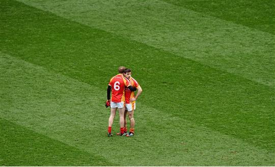 So close yet so far: Tom Cunniffe consoles Castlebar Mitchels captain Donal Newcombe after the full time whistle. Photo: Sportsfile
