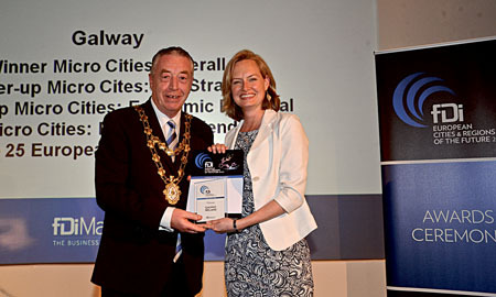 Courtney Fingar, dditor of The Financial Times group fDi magazine presenting Mayor of Galway, Cllr Padraig Conneely with the European Micro City of the Year Award at fDi European Cities and Regions of the Future 2014/15 awards ceremony held in Cannes recently.