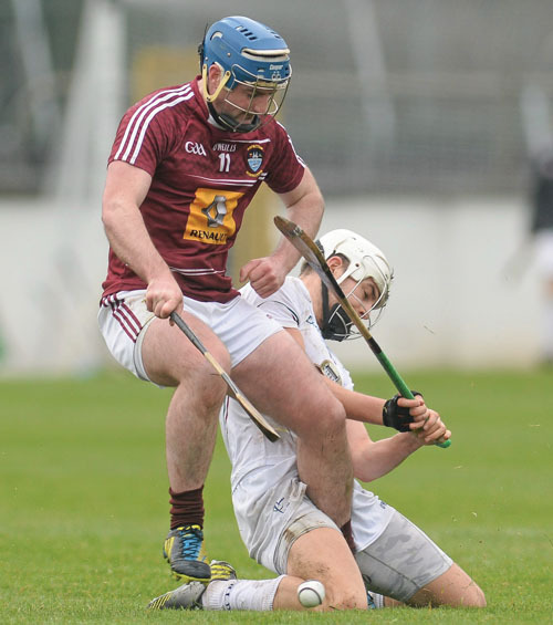 Derek McNicholas, Westmeath in action against Paul Divilly, Kildare. Photo: Sportsfile