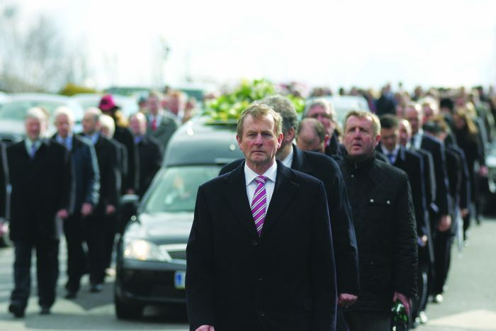Taoiseach Enda Kenny leads the funeral cortege of the late Deputy Nicky McFadden from the Church of Our Lady  Queen of Peace, Coosan to her final resting place at Coosan cemetery yesterday.