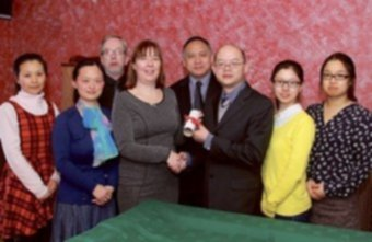 Pictured in the Threadneedle Café at The Anno Santo Hotel are Mr Xia, director of UCCCI, presenting the agreement to Shelagh Nangle, general manager of IIHCS, and Kam Chin, chairman of ICSG, along with Eamon McNamara  of the Anno Santo Hotel, local teachers Cathy Geng and Xu Jin, and UCCCI teachers Yuan Wen Feng and Jiang Fan. Photo: Mike Shaughnessy