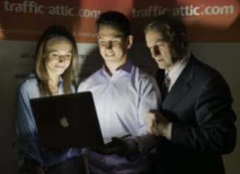 Taoiseach Enda Kenny with  Brendan and Sophia McHugh at the launch of Trafficattic.com.