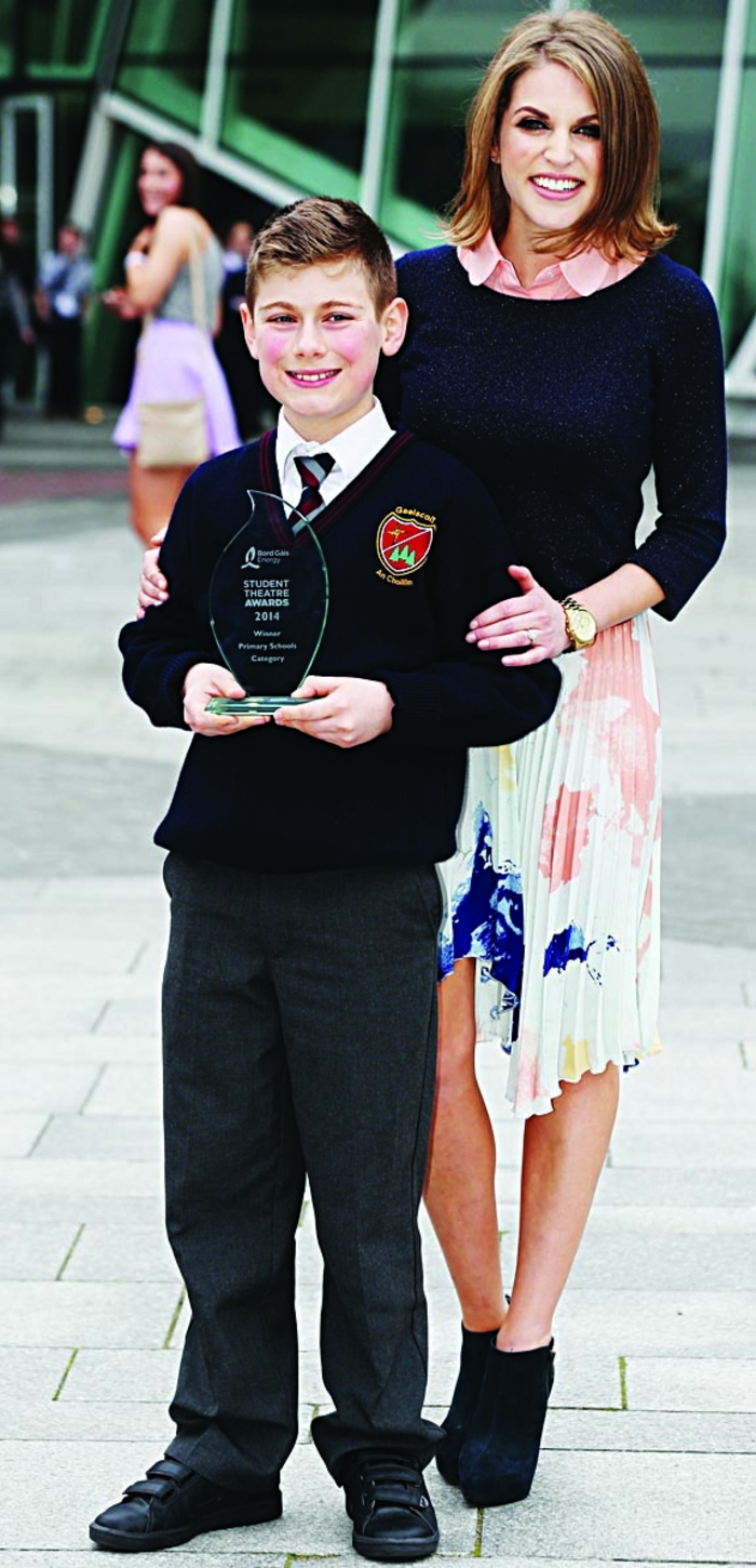 Actress and writer Amy Huberman presents Fionn with his award