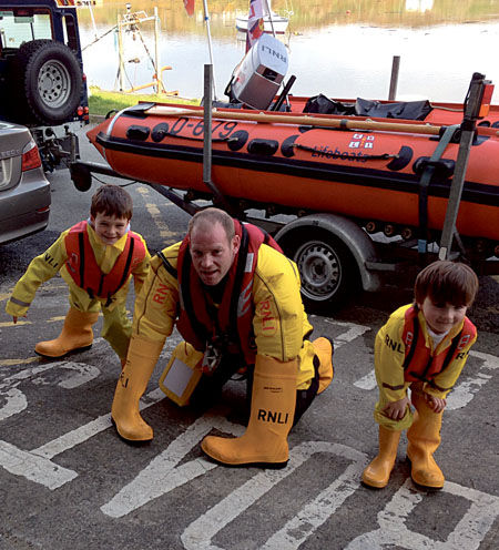 Ronan Mullen (7yrs) with father and Clifden RNLI crewmember James Mullen are joined by Rian King (5yrs) at the lifeboat station to give it some welly for the RNLI Mayday campaign.