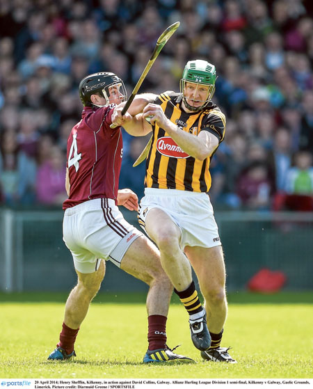 The master Henry Shefflin of Kilkenny is challenged by  Galway's David Collins in Sunday's Allianz Hurling League division one semi-final at the Gaelic Grounds, Limerick.