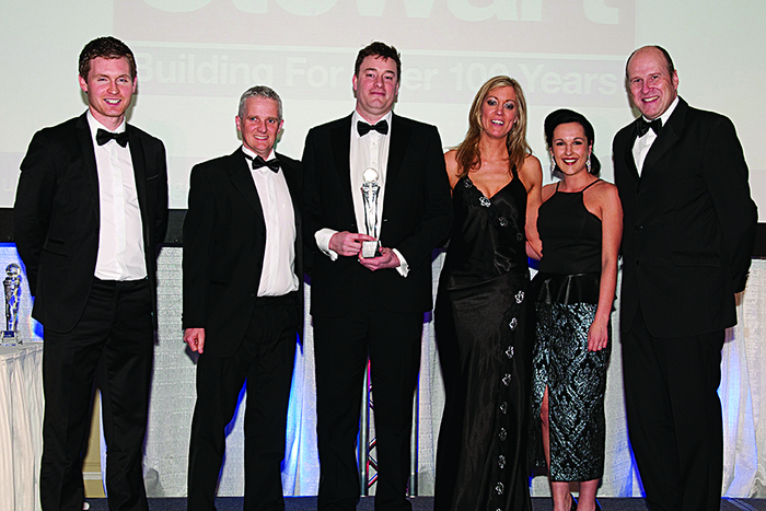 Contractor of the Year at Irish Building and Design Awards 2014: Owen O'Flaherty of ESS Safeforce (sponsor), with Brian Gorman, Paul Stewart, Rachael Stewart and Lorraine Power of Stewart Contractors,	with MC Ivan Yates.