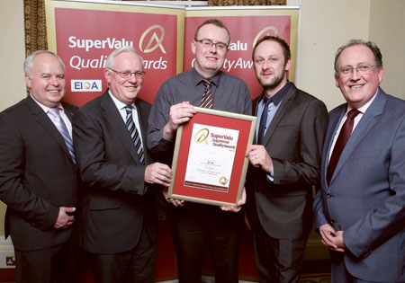 At the SuperValu Quality Awards Ceremony 2014, Martin Kelleher, managing director SuperValu and Martin Roper, technical director at Excellence Ireland Quality Association present a Supreme Excellence Award to Rory Cronin, Eoin Kennedy, and Jimmy Buckley from Buckley's SuperValu, Mullingar.