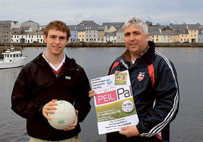 Alan Campbell, juvenile chairman of Fr Griffins Éire Óg, discusses details of the Peil Pal initiative with Thomas Cox, club chairman.