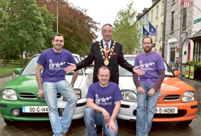 Mayor Padraig Conneely pictured with Terry Keenan, Patrick Curran, and Adrian O'Malley who are driving 10,000km in two Nissan Micras to raise awareness and funds for Cystic Fibrosis Galway. 										Photo: Joe Travers.