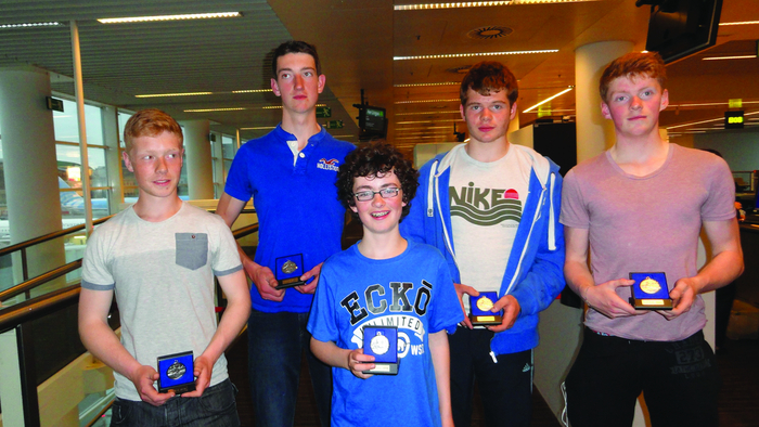 The winning Jes men's junior 18 four (l to r) Donal Coen, Eoghan Walls-Tuite, David Young (cox), Kai McGlacken, and Luke Rigney.