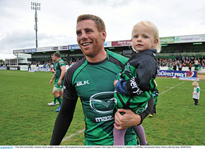 Coming home: Gavin Duffy, with his daughter Jessica, age 2, after he played his last home match for Connacht at the start of May. Photo: Sportsfile