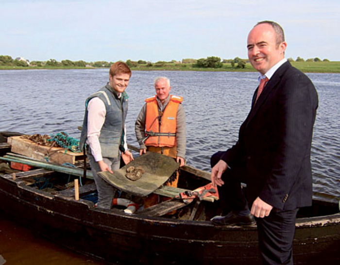 Kilcolgan native and Ireland u-20 Rugby captain Sean O'Brien helps local oyster farmer Michael Egan deliver fresh oysters to Martin Forde, Clarinbridge Oyster Festival committee chairman, at the launch of the sixtieth Clarinbridge Oyster Festival. Photo:-Mike Shaughnessy