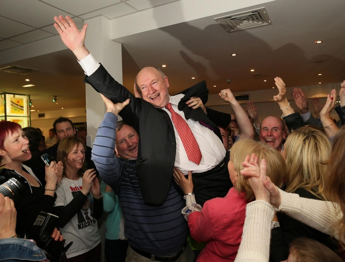 Michael Kilcoyne is hoisted high by his supporters in the count centre after his election yesterday. Photo: Michael Donnelly