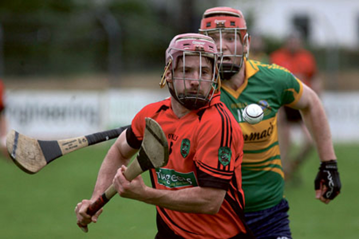 Gort's Michael Mullins and Tommy Larkin's Gerard Kelly during the Senior Hurling Championship at Athenry.