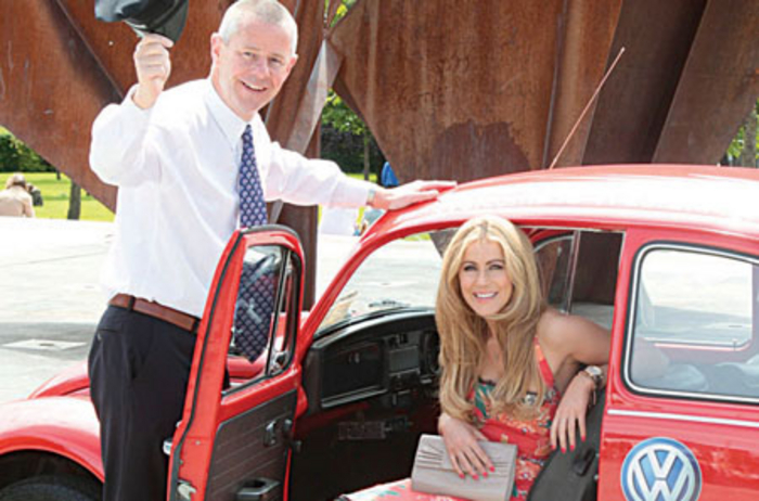 Launching the Thanks For The Lift campaign to celebrate fifty years of Western Motors are MD James McCormack and model Mary Lee. For the month of June Western Motors is offering fifty people lifts to their destinations within Galway in unique and classic cars of their choice. See Western Motors Facebook page for details.
