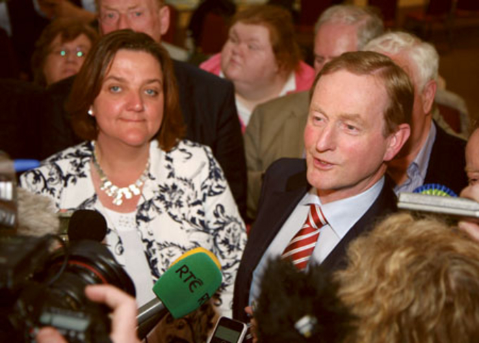 Enda Kenny with Gabrielle McFadden speaking to the press at Kenagh on Saturday. Photo: Thomas Gibbons