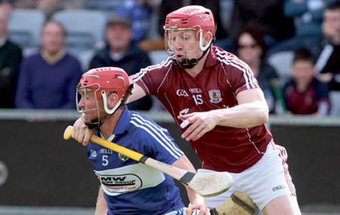 Galway's Joe Canning puts Joe Fitzpatrick of Laois under pressure in action from the Leinster Hurling Championship game at O'Moore Park, Portlaoise on Sunday.  Photo:-Mike Shaughnessy