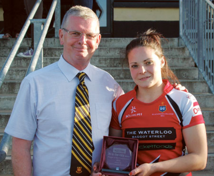 Buccaneer's president Ray Fagan presents the 7s in the City Player of the Tournament to Blackrock College's Amy Smith.