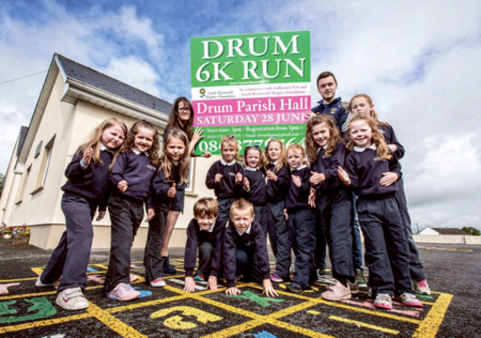 Karen Cunningham, South Westmeath Hospice; Roscommon footballer, Donal Shine, and children from Ardkeenan NS at the launch of the fun run.