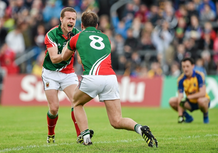 Just enough: Aidan O'Shea and Andy Moran celebrate at the end of Mayo's win over Roscommon. Photo:Sportsfile