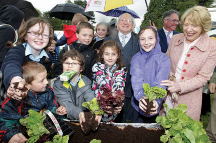 The President of Ireland, Michael D Higgins and wife Sabina lend a helping hand to Cloghan's Hill students with their planting. The school won a day trip to Bloom, a school tour of Dublin Zoo, and €500 worth of growing equipment in the Grow It Yourself campaign.