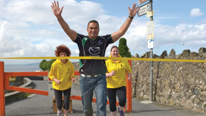 Connacht Rugby head coach Pat Lam, with Brenda McCarthy and Justine Delaney, hits the front in his support of the Galway Simon Kick Assphalt run on Sunday June 22.