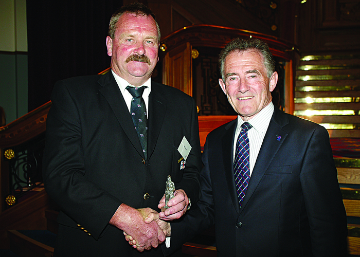 Frank Acton from Clifden receives his Inscribed Statuette from RNLI chairman Charles Hunter-Pease.