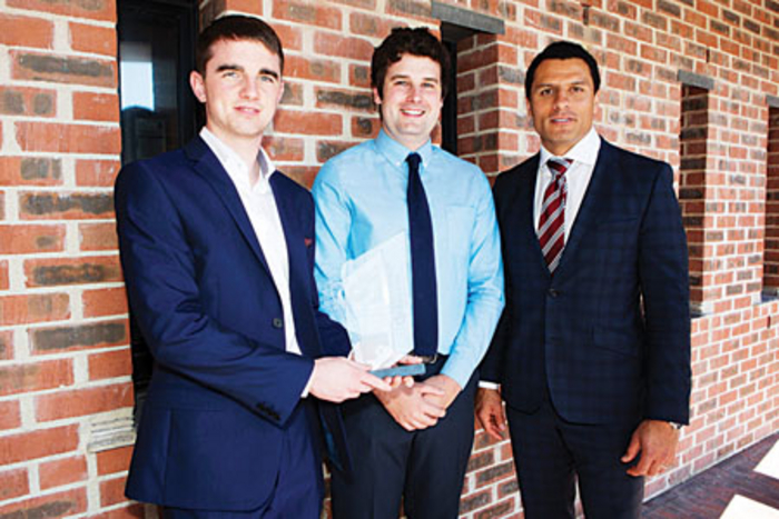 Caption (l-r): NUI Galway Bachelor of Science students Lorcan Farrell and Domhnall Walsh with Dougie Howlett from Munster Rugby after receiving a merit award at the Enterprise Ireland Student Entrepreneur Awards.