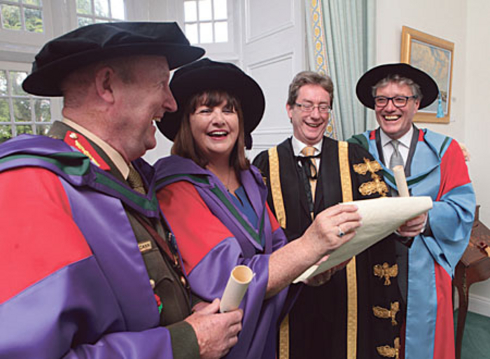 NUI Galway president, Dr Jim Browne, with (l-r) Lt Gen Sean McCann, Commissioner Maire Geoghegan-Quinn, and Finian O'Sullivan who received honorary degrees.