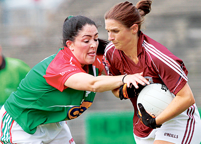Galway's Lorna Joyce protects possession from Mayo's Mary Naughton in the TG4 Connacht Senior Ladies final at McHale Park, Castlebar, on Sunday.  			Photo:-Mike Shaughnessy