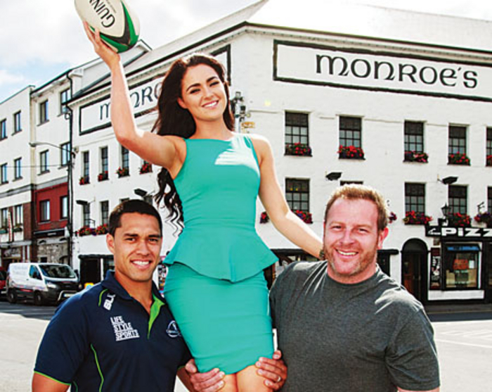 Pictured alongside Connacht Rugby outhalf Miah Nikora and Robert Monroe of Monroe's Live is Miss Sunday World, Laura Fox. Photo: Darius Ivan.