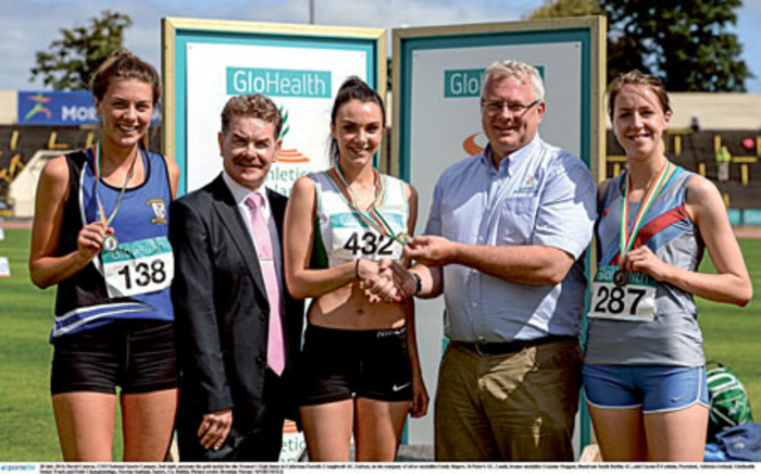 Cathriona Farrell (centre), Craughwell AC, being presented with the gold medal for the women's high jump by David Conway (second right), CEO National Sports Campus, and Ciaran O Cathain (second left), president of Athletics Ireland, at the GloHealth Senior Track and Field Championships.