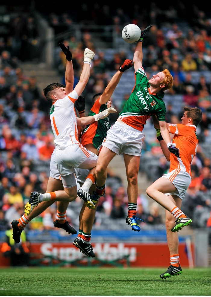 Conor Byrne rises highest to a high ball ahead of Armagh goalkeeper Ryan Kearney in the All Ireland Minor Football Championship Quarter Final. Photo: Sportsfile