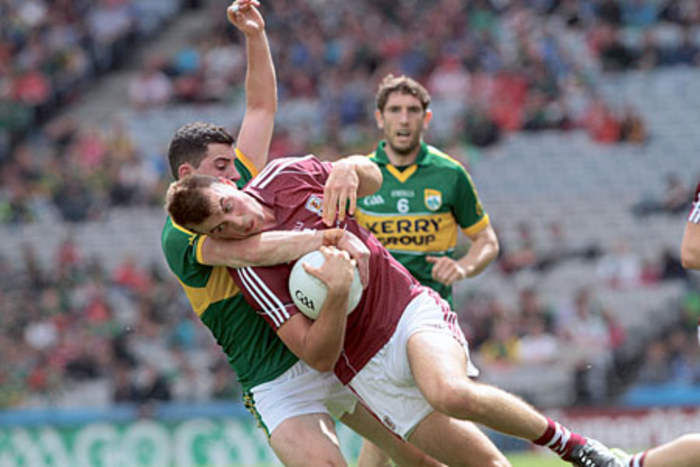 Galway captain Paul Conroy under pressure from Kerry's Michael Geaney in the All Ireland senior championship quarter-finals at Croke Park on Sunday.  Photo:-Mike Shaughnessy