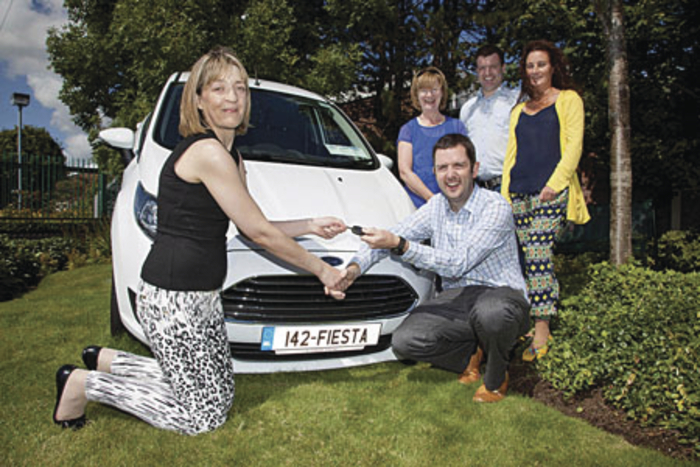 Mary O'Connor, winner of a new Ford Fiesta 1.2 Zetec at Boston Scientific and East Galway Cancer Care's charity car raffle in which €37,500 was raised for the charity. Also pictured are Conor Dolan, director quality assurance, Boston Scientific Galway, Mary Jordan, East Galway Cancer Care, Ken McCarthy and Anne Connolly, charity committee, Boston Scientific.