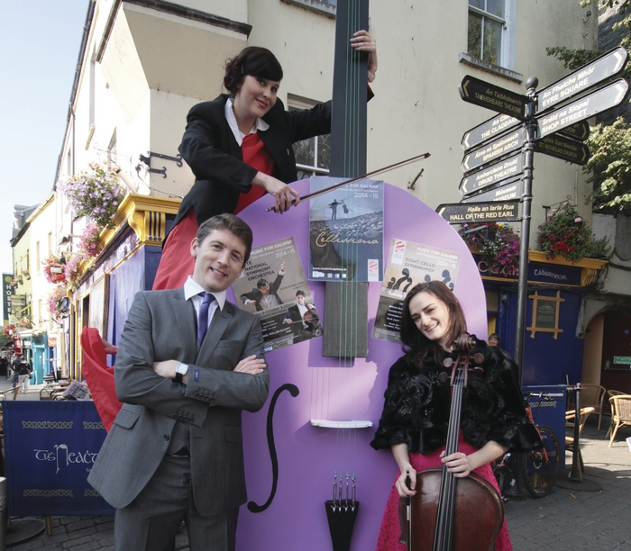 Music For Galway artistic director Finghin Collins and cellist Sarah Joyce launch Music for Galway's 34th International Concert Season - Cellissimo with the help of perfornance artist Beau Holland and her giant cello on Monday. Photo:- Mike Shaughnessy