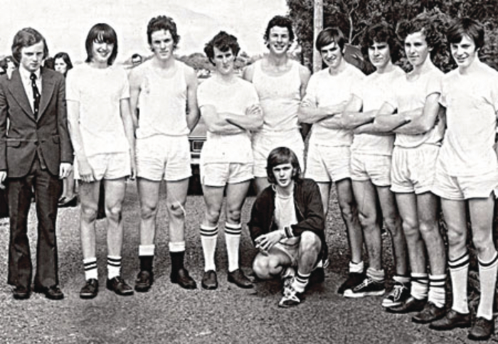 The Jes senior eight team that won the National Championship in 1974. From left: Eamonn Lawless (coach), Paul Lawless, John Murphy, Kennedy O'Brien, Joe Healy, Vincent Rogan, Colm O'Donnellan, James O'Kelly, and Brendan O'Dea, with Seamus Storan (cox) in front.