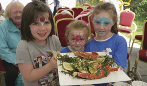 Mary's children Tara and Erin, with their friend Ailish, pictured at the recent fish cookery demonstration day.