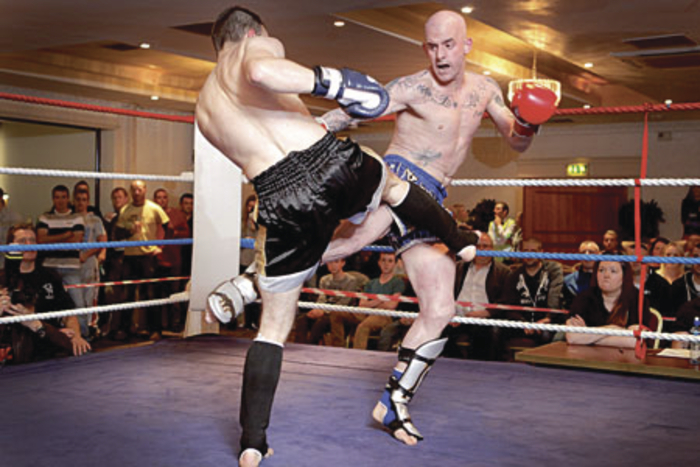 Knocknacarra's new champion Paul Huish of the Black Dragon Kickboxing Club lands a leg kick on French Champion Johnathan Main en route to the IKF European title.