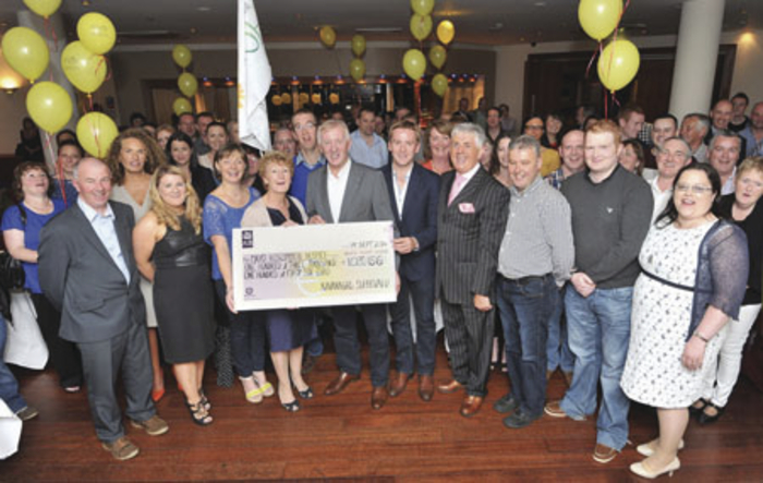 Management and staff from the Kavanagh Group present a cheque for €100,000 to Mayo Roscommon Hospice.