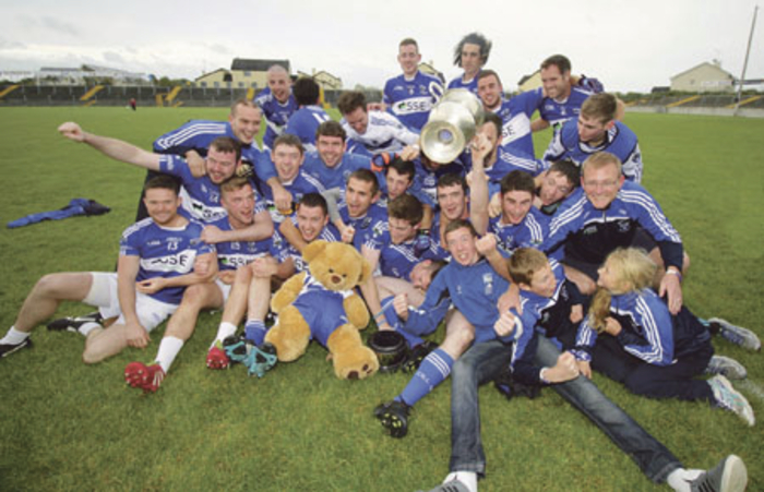 Congratulations boys in blue: Killanin celebrate victory over neighbours Moycullen in the intermediate football championship final in Tuam on Sunday.					Photo: Mike Shaughnessy