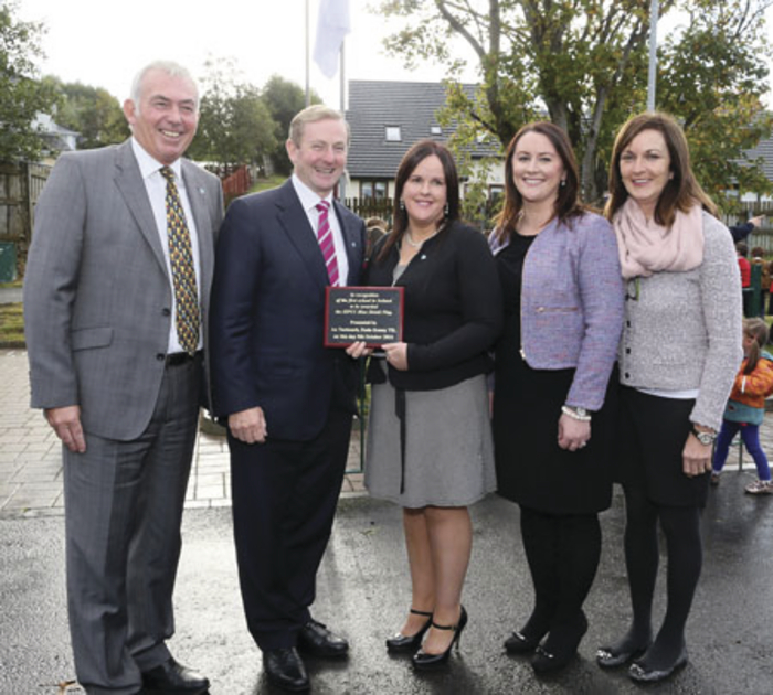 Gaelscoil na Cruaiche, Westport, are presented with a plaque by An Taoiseach Enda Kenny in recognition of being the first school in Ireland to receive the ISPCC Blue Shield Flag for their ongoing anti-bullying work. Photographed, from left, are: Ashley Balbirnie, ISPCC CEO, An Taoiseach Enda Kenny, principal Mairéad Ní Ruáin, Fiona Jennings, ISPCC West representative, and Sandra Uí Chorcoráin, chairperson of the school's board of management. Photo: Michael Donnelly.