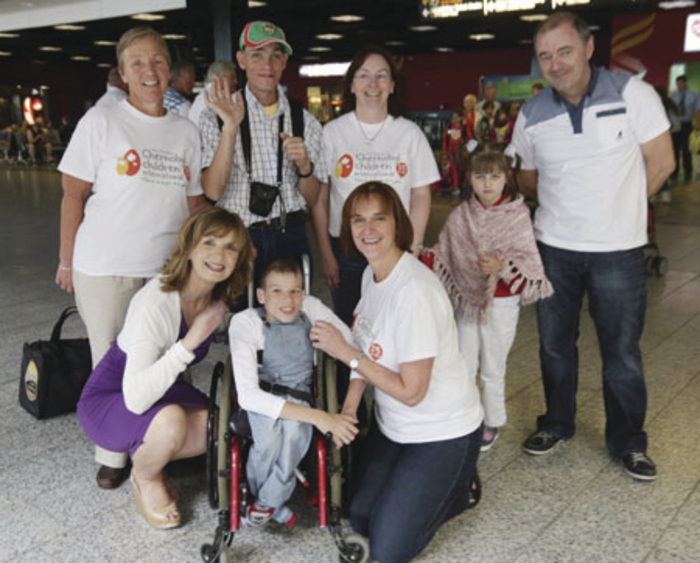 Chernobyl charity workers Ann Coleman, Marie Cox, Julie and Brendan Chambers are pictured with Adi Roche at Dublin Airport meeting the young Belarusians, Mischa, Igor, and Angelina, who stayed with them on a rest and recupperation holiday last summer.
