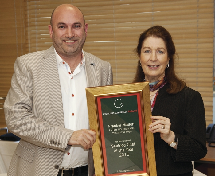 Frankie Mallon, chef and proprietor of An Port Mor, Westport, collects his award from Georgina Campbell.