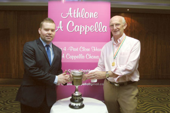 Conor Carrig, Athlone Springs Hotel, and David Farmer, musical director, pictured with the Athlone Trophy during recent celebrations in the hotel to mark the group's gold medal at the annual Barbershop Harmony Convention. Photo: molloyphotography