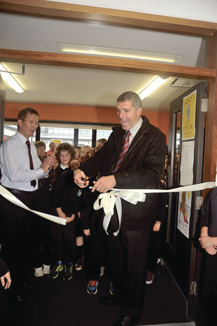 Pictured opening the new school library in Oughterard are Galway football manager Kevin Walsh and principal Micheal O Domhnaill. Pic: Tom Broderick