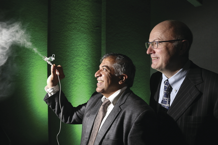 Professor Abhay Pandit, NUI Galway, pictured showing the latest aerosol technology for drug delivery to Professor Mark Ferguson, director general of SFI. The aerosol allows drugs to be nebulised into a fine particle mist that can be absorbed through the lungs while maintaining drug integrity.